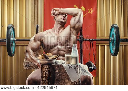 Old Fashion Bodybuilder Doing Exercises In Old School Gym Looking At Syringe, Injector. Handsome Cau