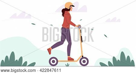 Young Woman Wearing A Protective Helmet Rides An Electric Scooter In A Park. Eco Friendly Vehicle Co