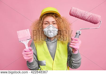 Studio Shot Of Happy Female Industrial Worker Supplies Maintenance Service Ready For New House Paint