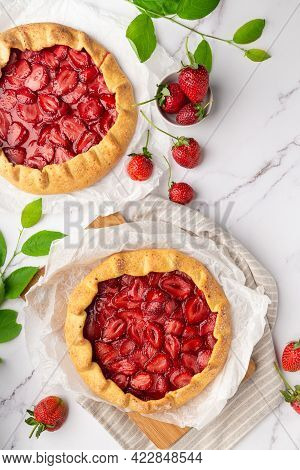 Fresh Homemade Galettes With Strawberries On White Marble Background. Top View.