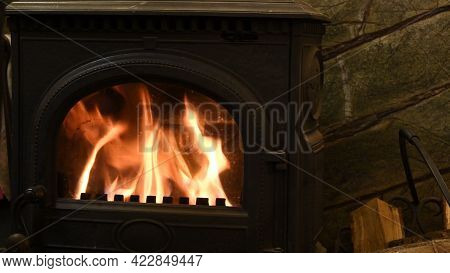 Selective Focus Burning Fire In Cast-iron Potbelly Stove Of Retro Style Interior. Flame In Antique F