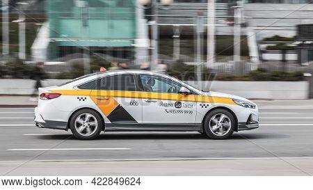 Moscow , Russia - April 2021: White Yandex Taxi On The Moscow Streets In Motion. Business Class Hyun