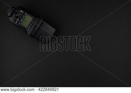 External Camera Flash Isolated On A Black Background