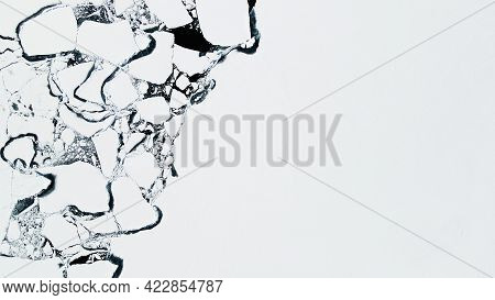 Melting Ice On The Shore Of Baikal Lake In Spring. Aerial Drone View. Baikal Lake, Siberia, Russia.