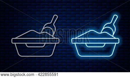 Glowing Neon Line Cat Litter Tray With Shovel Icon Isolated On Brick Wall Background. Sandbox Cat Wi