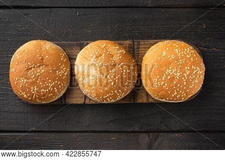 Hamburger Bread Homemade Brioche Hamburger Buns Set, On Wooden Serving Board, On Black Wooden Table