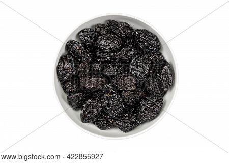 Prunes In A Bowl On A White Background. Dry Plums