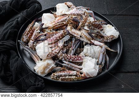 Fresh Raw Horse Crab, Blue Crab, Flower Crab Set, On Plate, On Black Wooden Table Background