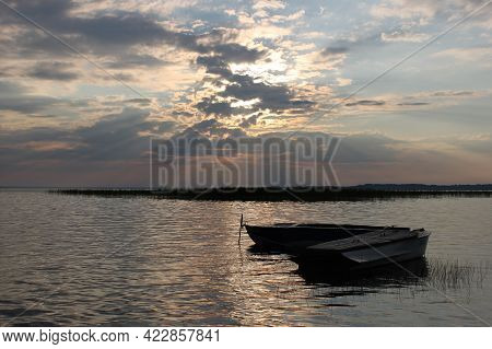 Tranquil And Romantic Landscape With Two Row Boats On The Background Of Sunset