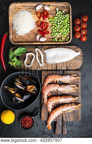 Traditional Valenciana Paella Seafood Ingredients With Prawns, Mussels, Rice And Spices On Black Con