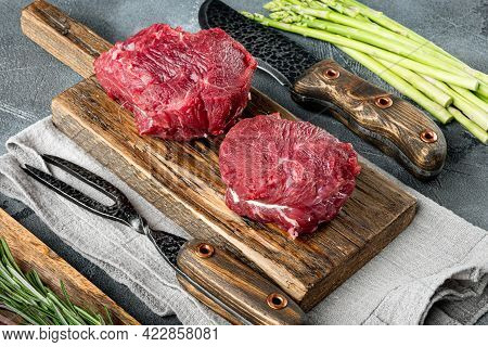 Fillet Mignon Tenderloin Raw Meat Veal  And Beef Steaks Set, On Wooden Cutting Board, On Gray Stone