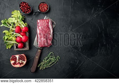 Beef Fillet Cut Raw With Ingredients Set, On Old Butcher Cleaver Knife, On Black Stone Background, T