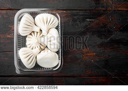 Manti Or Manty Dumplings, Popular Asian Dish Set, In Plastic Tray, On Old Dark  Wooden Table Backgro