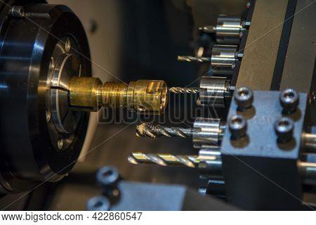 The Multi-tasking Cnc Lathe Machine Swiss Type Making The Thread On Brass Shaft Parts. The Hi-techno