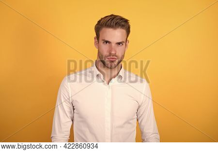 Pure Confidence. Young Sexy Macho On Orange Background. Confident Businessman In Formal Wear. Office