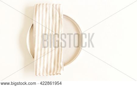 Blank Paper Sheet Card In A Bowl. Minimalist Ceramics Set Under A Linen Kitchen Towel With Stripes.
