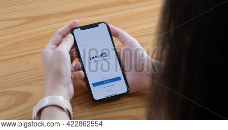 Chiang Mai, Thailand, Jun 6, 2021 : A Women Holds Apple Iphone Xs With Linkedin Application On The S