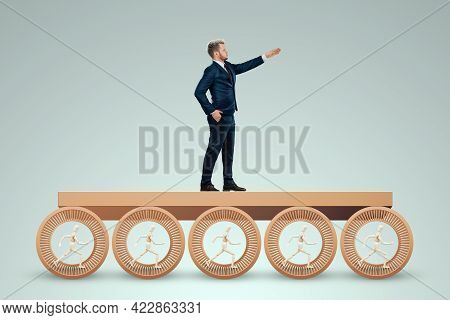 Puppets Run In The Hamster Wheel Working For Their Boss. The Concept Of Office Work, Emancipation Fr
