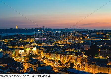 Lisbon At Night, The Capital Of Portugal By River Tagus