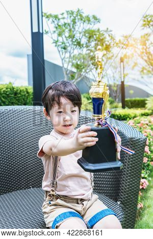 Happy Child Showing Trophy Excited Young Boy Win A Competition Of Sport Adorable Kid Proud Of Himsel