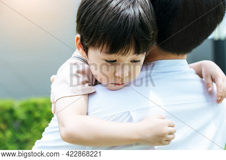 Little Handsome Child Hug Father During Dad Carry Him And Taking Son Go Home After School Young Boy