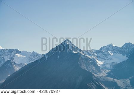 Atmospheric Mountain Landscape With Black Mountain Silhouette With Sharp Rocky Pinnacle With Snow In