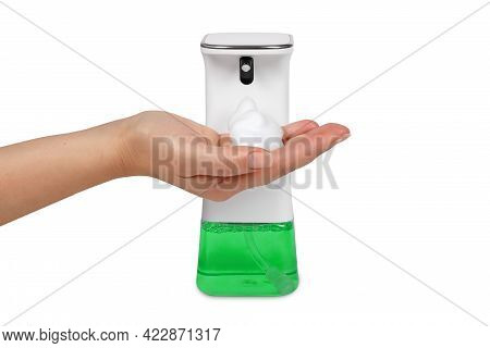 A Liquid Soap Dispenser With A Hand Underneath It Produces Lather For Hand Washing.