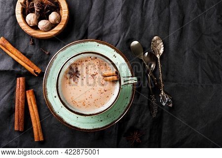 Cup Of Traditional Indian Tea With Milk And On A Linen Tablecloth, Top View. Masala Chai