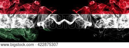 Hungary, Hungarian Vs Yemen, Yemeni Smoky Flags Side By Side.