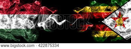 Hungary, Hungarian Vs Zimbabwe, Zimbabwean, Zimbo Smoky Flags Side By Side.