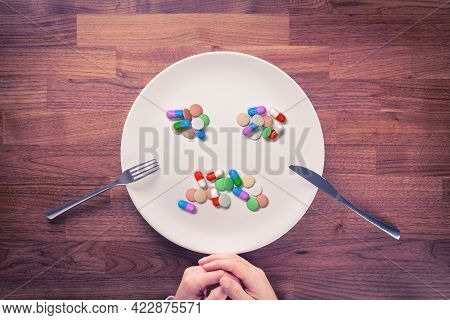 Overuse Of Drugs Or Pills, Dietary Supplements And Vitamins Concept. Person Prepared For Eating With