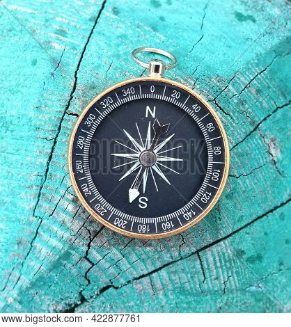 Round Compass On Natural Wooden Background As Symbol Of Tourism With Compass, Travel With Compass An
