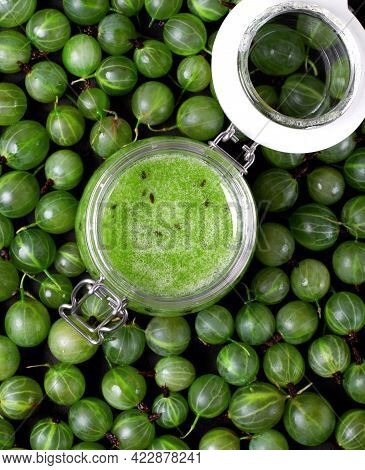 Gooseberry Jam In Glass Jar And Berries Around. No-cook Jam. Food Background. Top View