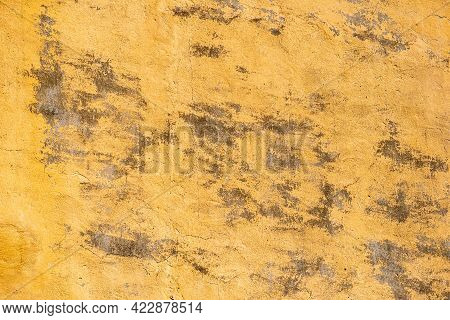 Ocher Grunge Wall Texture With Uncovered Pieces Of Surface. With Cracks In An Industrial Building, G
