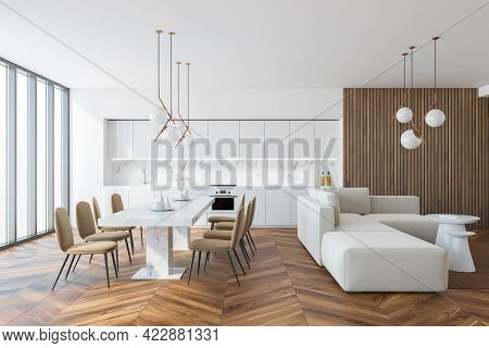 Interior Of Stylish Kitchen With White And Wooden Walls, Wooden Floor, White Countertops And Cupboar