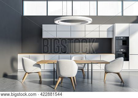 Minimalist Kitchen Set With Wooden Table And Four Chairs On Grey Floor. Light Dining Room With Windo