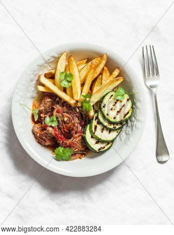 Slow Cooker Beef Stew With Grilled Zucchini And French Fries On A Light Background, Top View