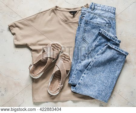 Women's Casual Walking Wear - Comfortable Leather Sandals, Beige T-shirt And Blue Jeans On A Light B