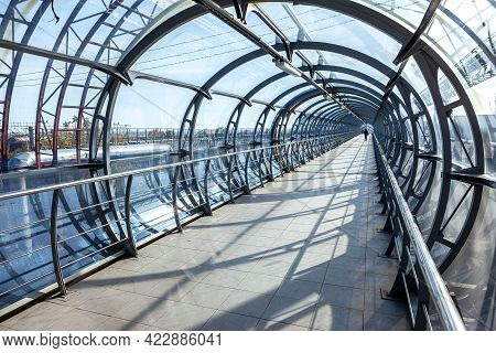 Pedestrian Bridge From Steel And Glass For Crossing Over The Railway Tracks In Samara, Russia