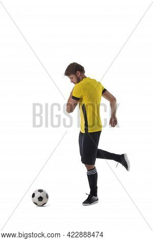 Soccer Player Is Kicking Ball Isolated On White Background