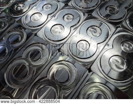 Shiny Metal Machined Digit 8 Plates Tiled Tightly - Full Frame Background