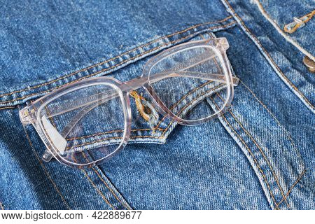 Eye Glasses With Transparent Frames On The Pocket Of A Blue Denim Jacket, Trend Eyes Glasses, Retro