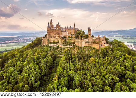 Hohenzollern Castle On Mountain Top At Sunset, Germany. It Is Landmark Of Swabian Alps. Aerial Sceni