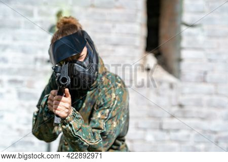 Young Woman In Action While Playing Paintball