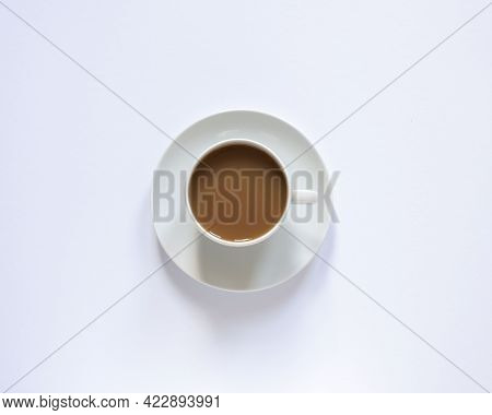 White Cup With Coffee On White. Top View, Minimalism, White On White