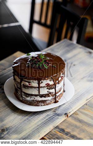 Chocolate Brownie Cake With Dark Chocolate On A Table