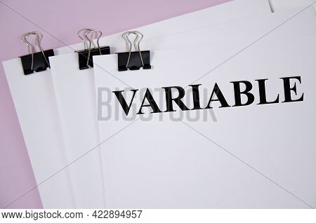 The Variable Word Written On White Piece Of Paper And Pink Background. Text