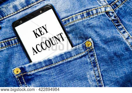Key Account The Text Is Written On The White Screen Of The Phone Shortly Lies In Jeans
