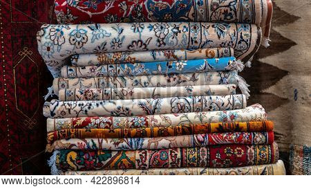 Isfihan, Iran - May 2019: Pile Of Traditional Iranian Carpet And Rugs In A Carpet Shop