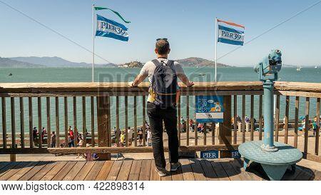 San Francisco, California, Usa - August 2019: Man Looking At The Sea At Fisherman's Wharf Pier 39